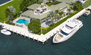 Aerial shot of the backyard of a luxury waterfront Fort Lauderdale home