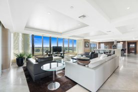 Image of 1 N Fort Lauderdale Beach Boulevard #2302 living room with couches and table | Florida Luxurious condos | Luxury Condo in Fort Lauderdale | luxury condo for rent in fort lauderdale | luxury rental in fort lauderdale | luxury home for sale | luxury condo for sale