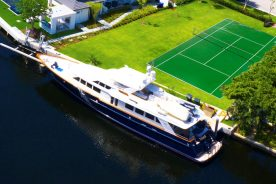 21 Compass Isle | Yacht parked aside tennis court