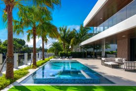 pool with palm trees | 188 Nurmi Drive | Florida Luxurious